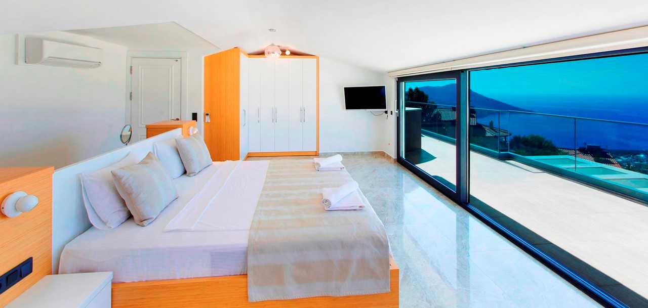 Master Bedroom With Doors Out To Roof Terrace