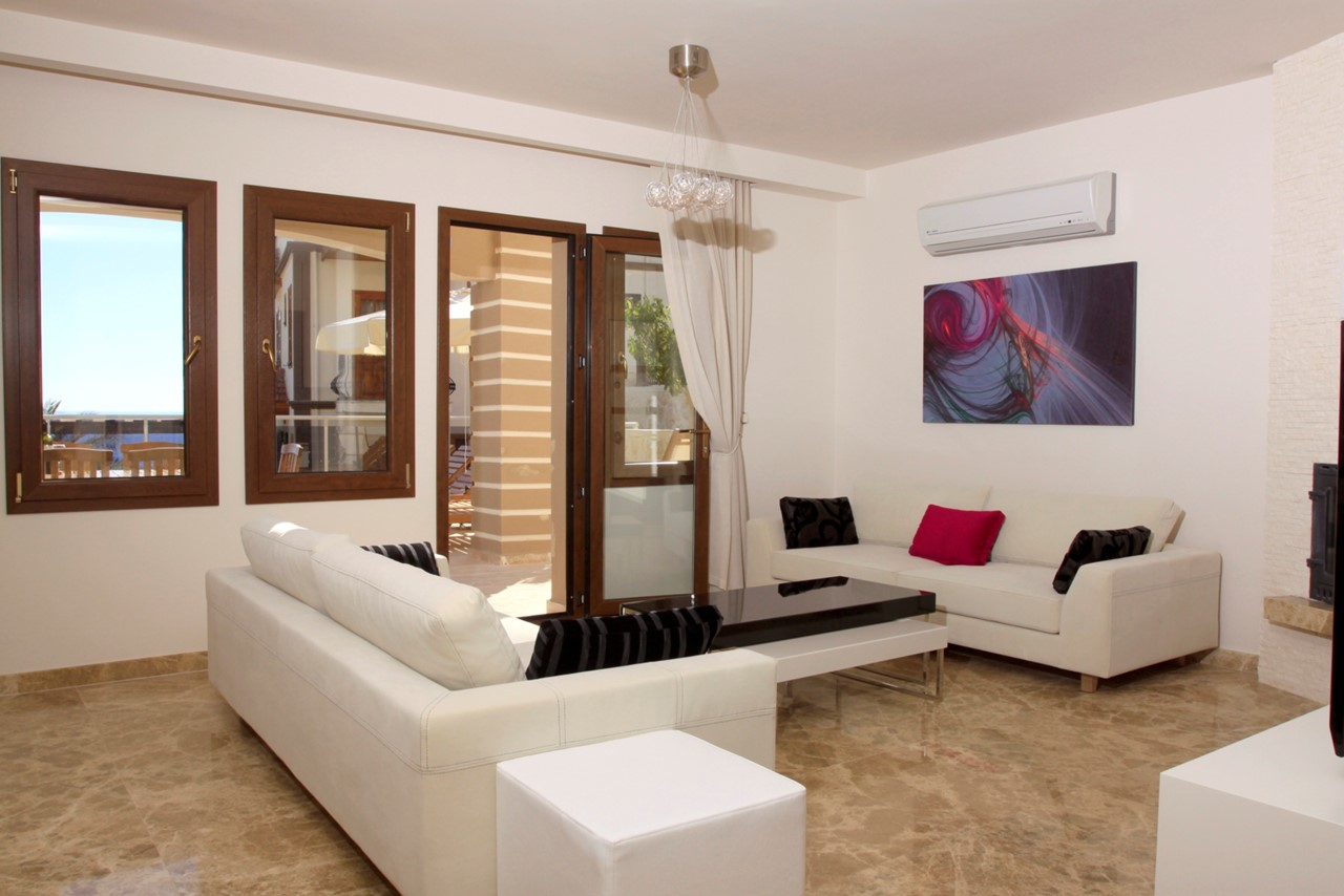 Beautifully furnished lounge with door to the terrace