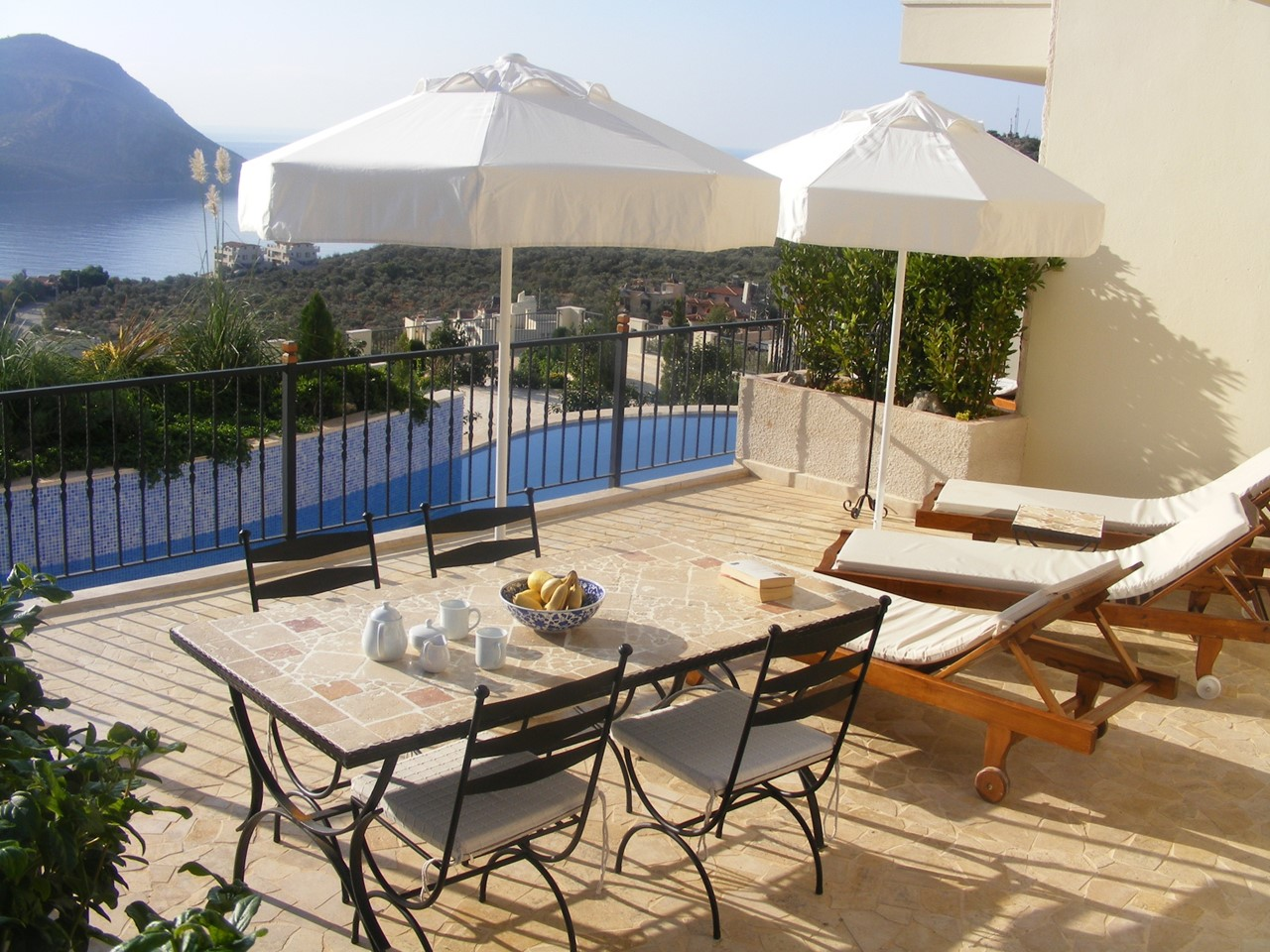 Imilia terrace with dining furniture
