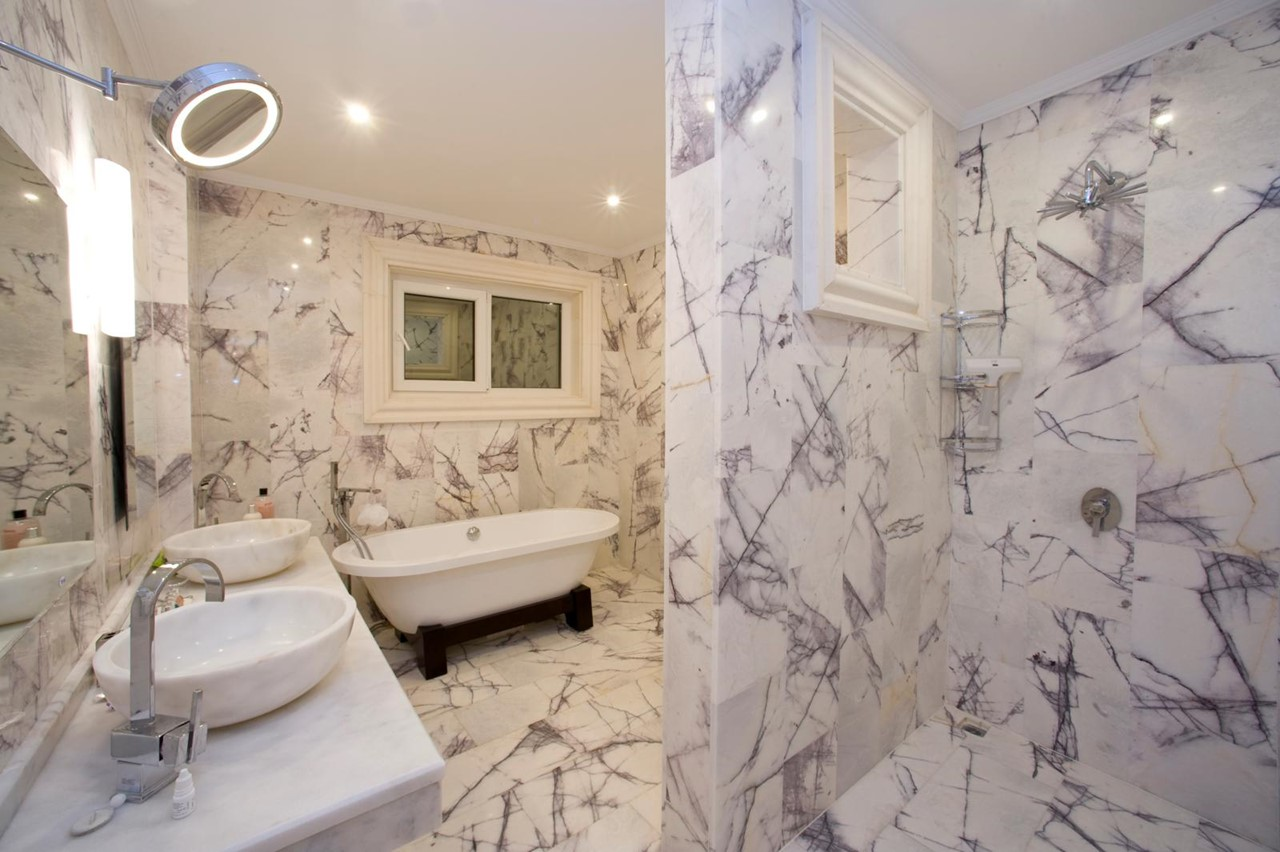 En-suite marble bathroom with double basins