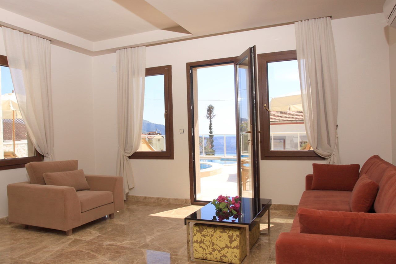 Living area with doors to pool terrace