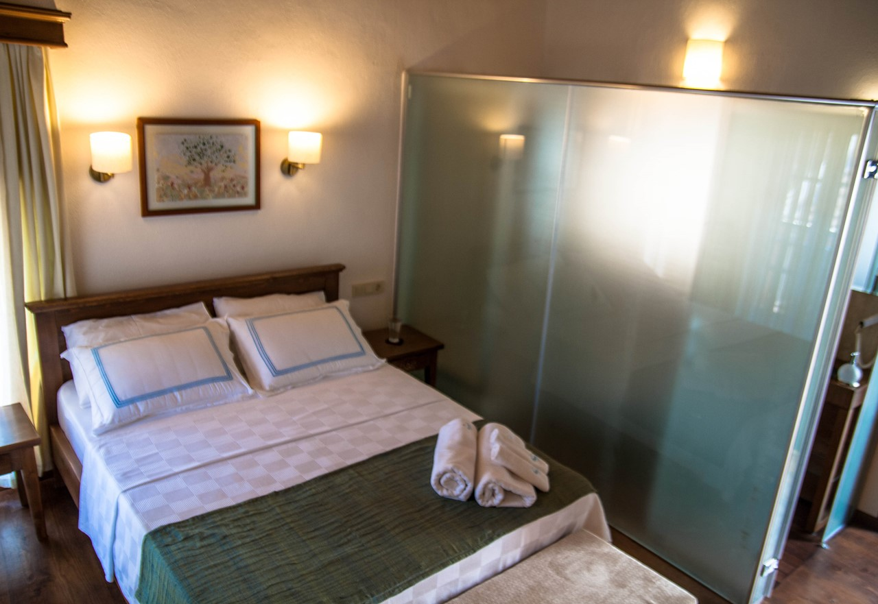 Room 4 with a glass screen separating the en-suite bathroom