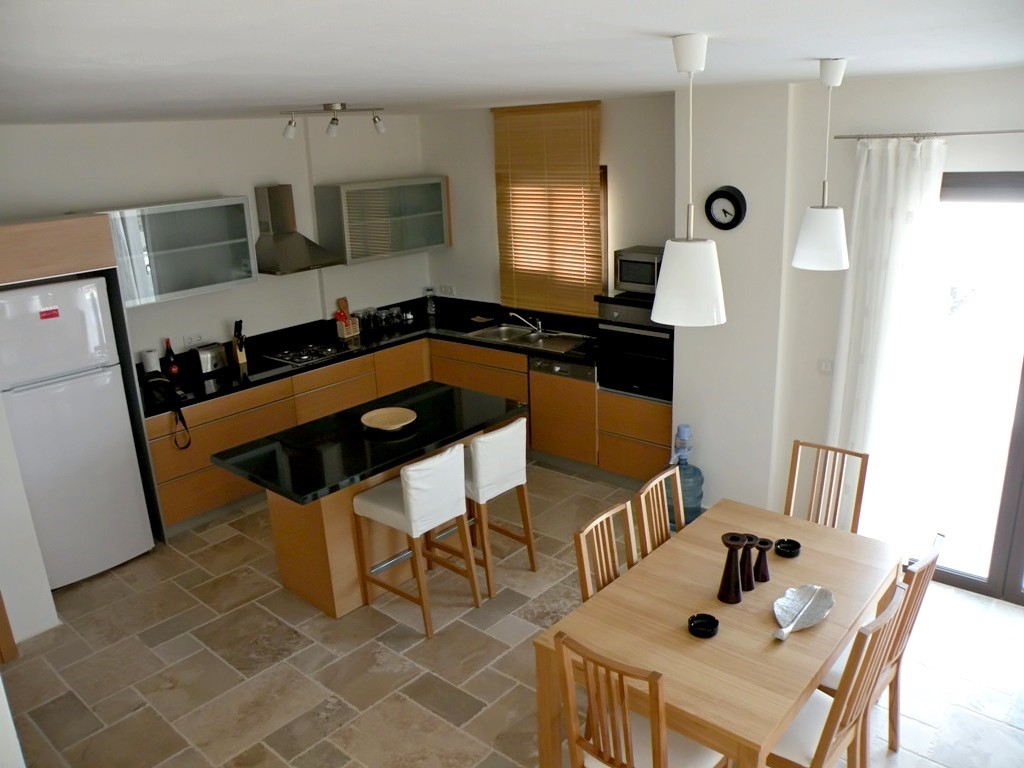 Fitted kitchen and dining area