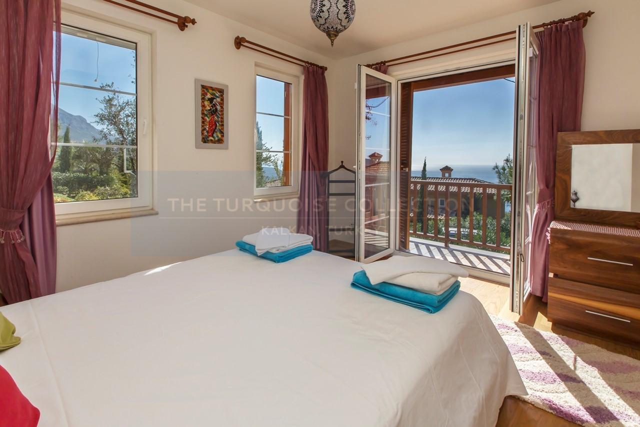 Master bedroom with sea view balcony