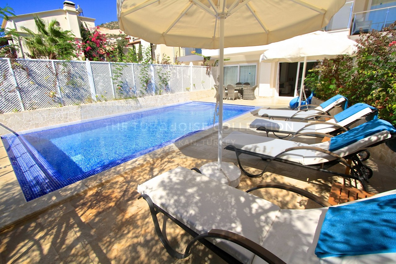 Spacious terrace with sunbeds and dining furniture