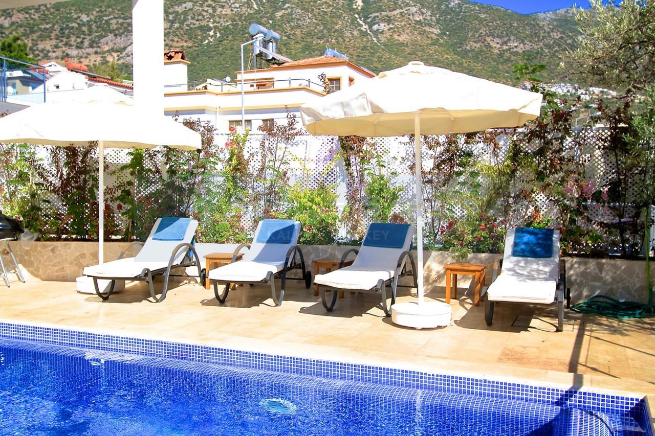 Sunbathe beside the pool