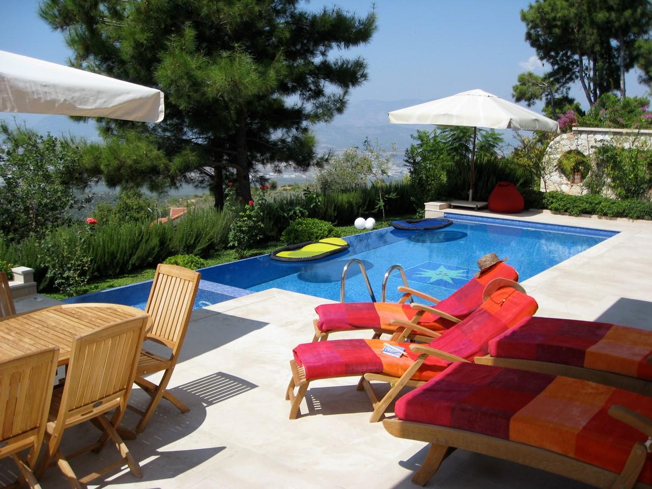 Sunbathe by the pool