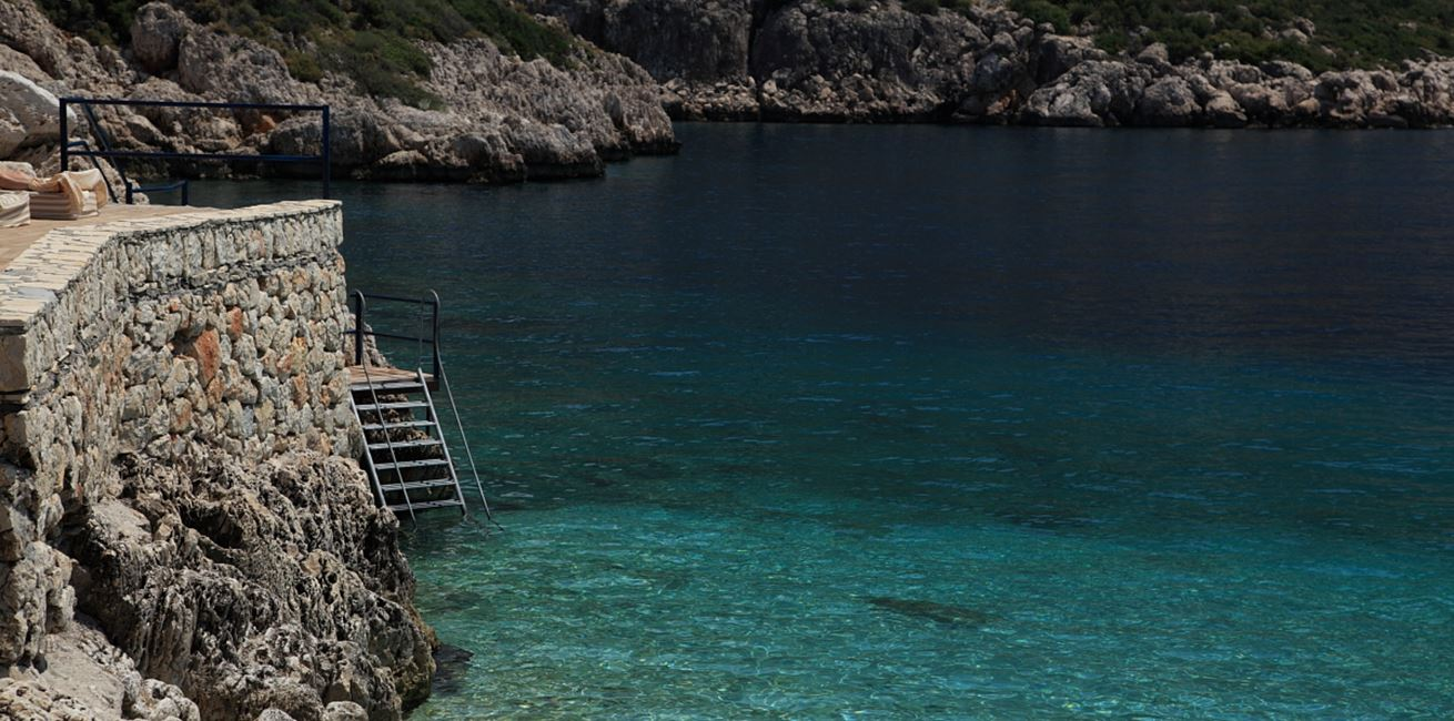 Steps into the clear blue water