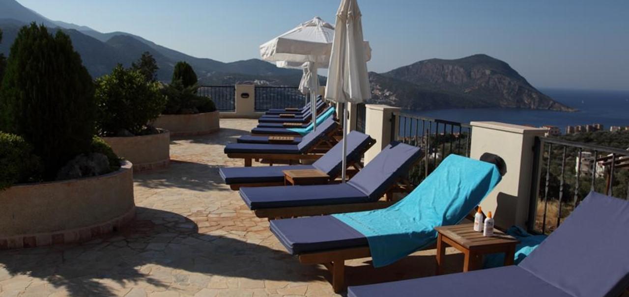 Large sunbathing terrace with sea views