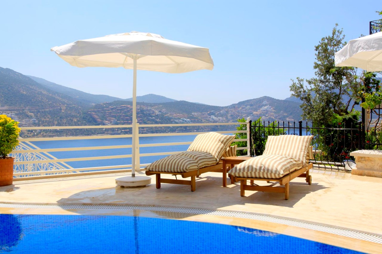 Pool terrace with comfortable sunbeds