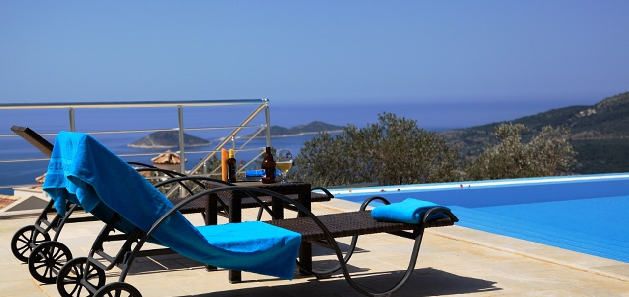 Sunloungers by the communal infinity pool