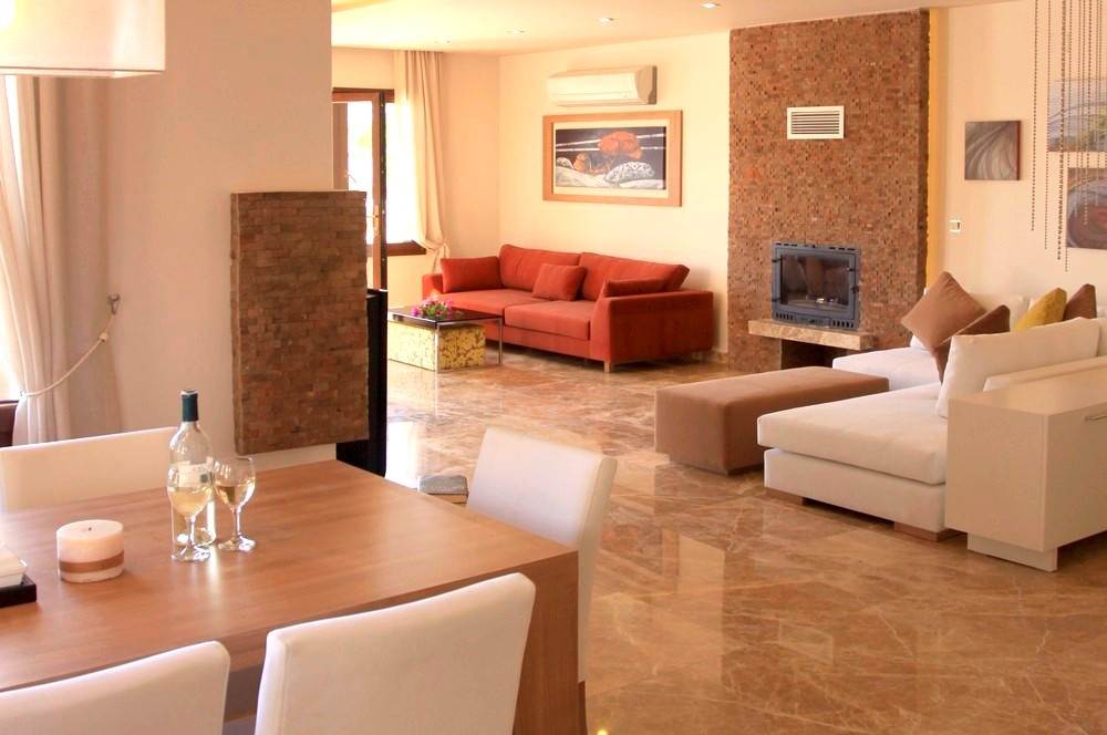Contemporary furnishings and a fireplace in the lounge