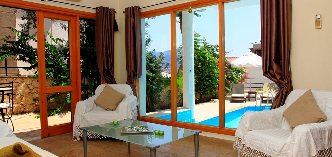 Living area with with views to swimming pool