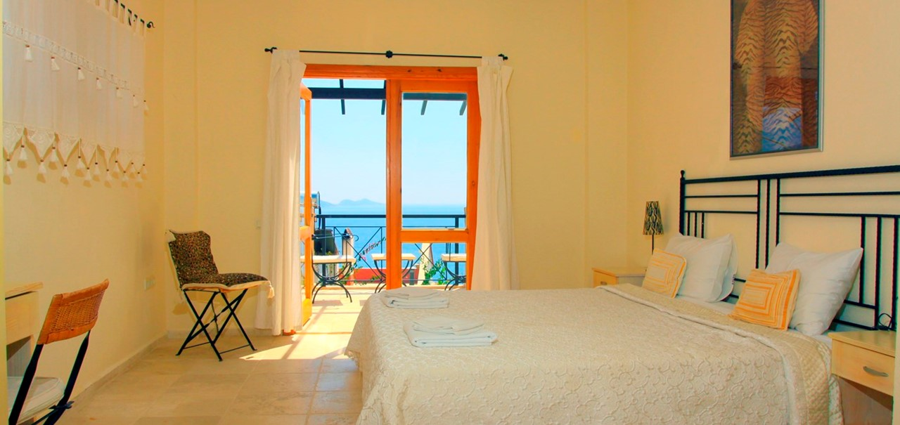 Spacious double bedroom with sea views
