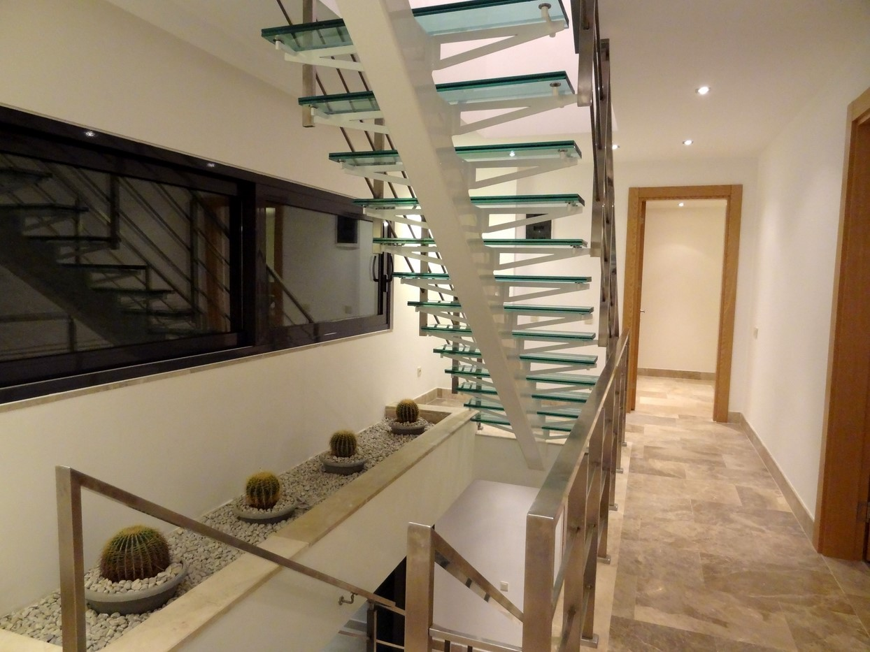 A glass staircase to the first and second floors