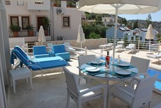 Spacious terrace outside the living area & right by the pool