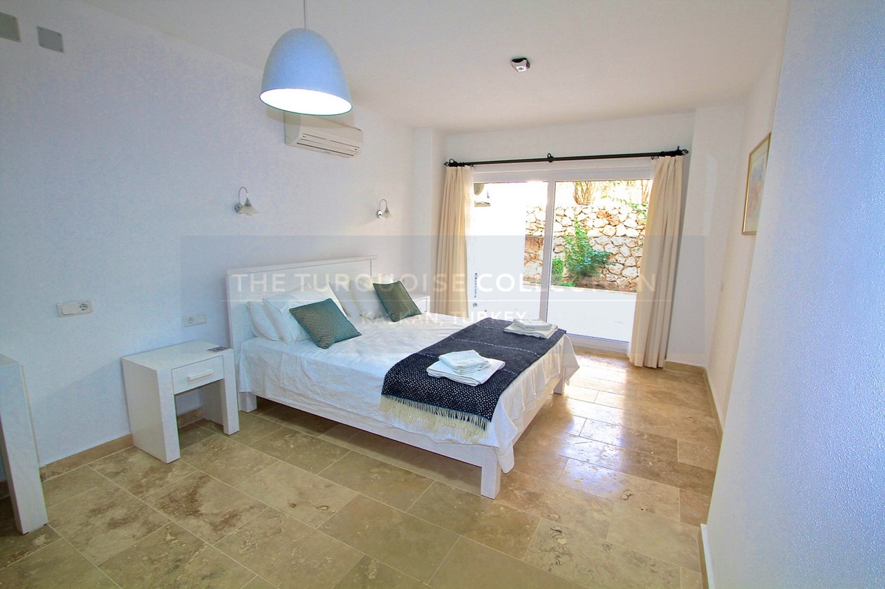 Spacious double bedroom with doors to terrace