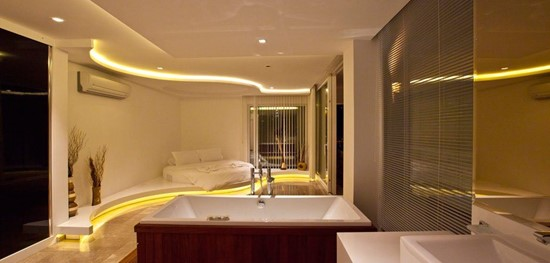 Master suite with jacuzzi tub and beautiful lighting