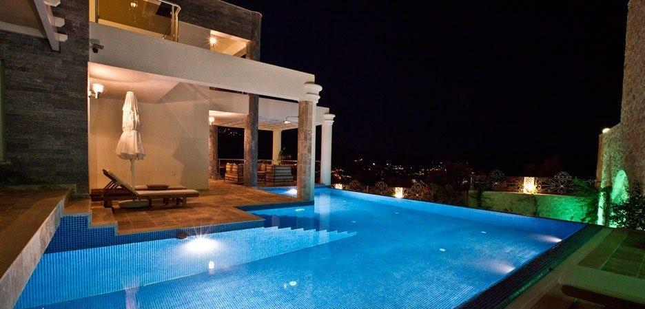 Infinity pool lit up at night
