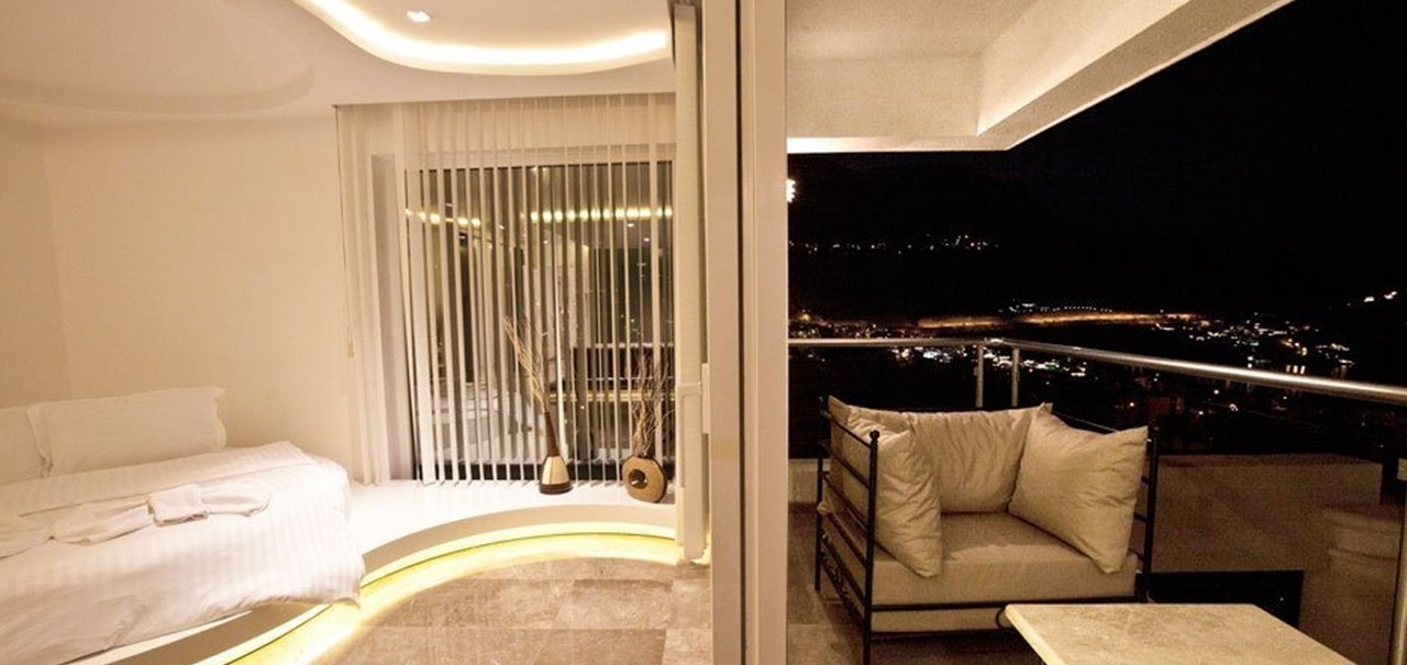 Large master suite with a balcony overlooking Kalkan bay