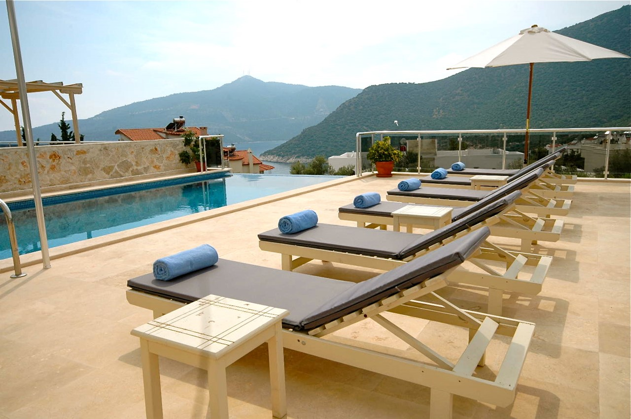 Cushioned Sunloungers For Guests